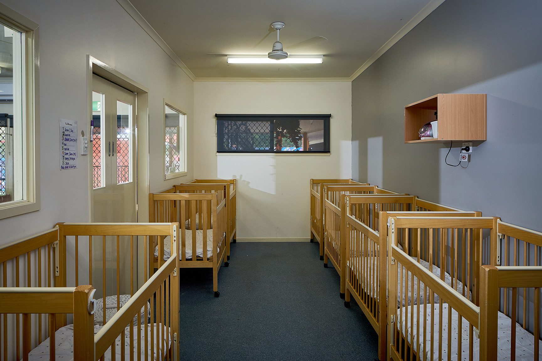 Nursery room with cots at Tadpoles Pacific Paradise